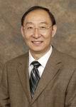 Dr. Yigang Wang